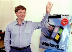 Microsoft CEO Bill Gates stands beside a model of the new Windows '95 product in 1995. Reuters